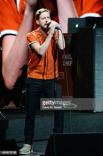 Ricky Wilson performs with Kaiser Chiefs at the global reveal of the new Jaguar XE in London at Earls Court on September 8 2014 in London England