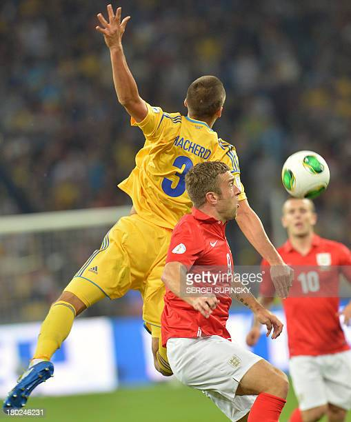 Riclie Lambert of England fights for a ball with Yevhen Khacheridi of Ukraine their Brazil 2014 FIFA World Cup qualifiers Group H football match in...