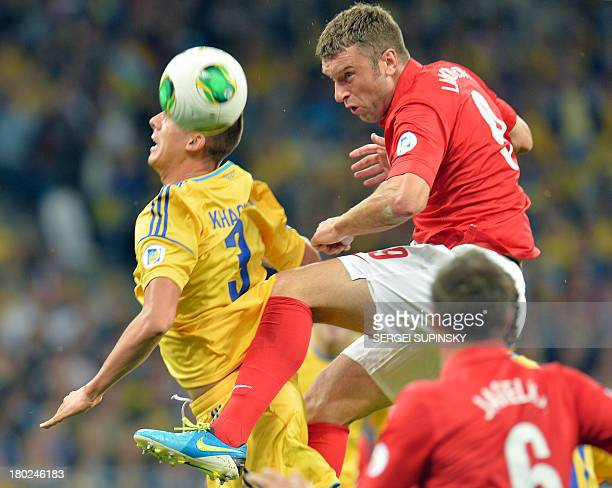 Riclie Lambert of England fights for the ball with Yevhen Khacheridi of Ukraine during their Brazil 2014 FIFA World Cup qualifiers Group H football...