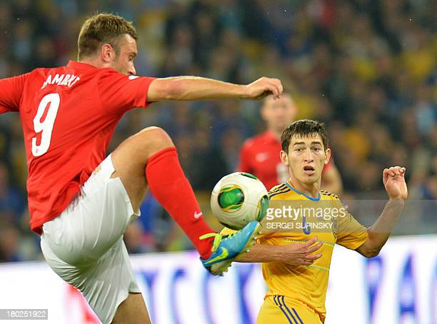 Riclie Wilshere of England fights for a ball with Taras Stepanenko of Ukraine during their Brazil 2014 FIFA World Cup qualifiers Group H football...