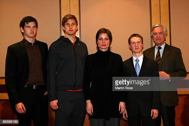 Rico Adlergerman goalkeeper Rene Adler Annika Schmitz Frank Steffen Elster and Georg Girardet pose during a photocall at the Westin Leipzig Hotel on...