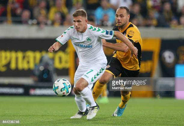 Rico Benatelli of Dresden battles for the ball with Levent Aycicek of Fuerth during the Second Bundesliga match between SG Dynamo Dresden and SpVgg...