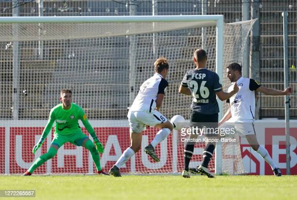 Rico Benatelli of St Pauli scores his team's second goal during the DFB Cup first round match between SV Elversberg and FC St. Pauli at...