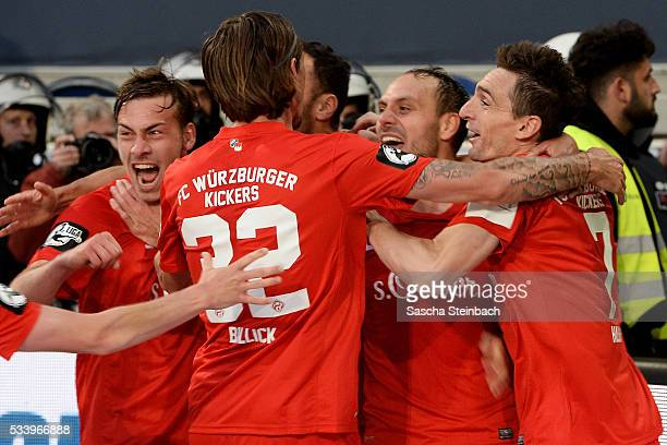 Rico Benatelli of Wuerzburg celebrates with team mates after scoring his team's second goal during the 2 Bundesliga playoff leg 2 match between MSV...
