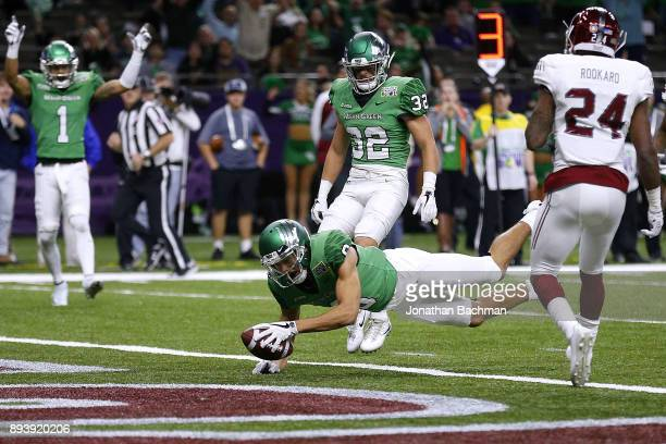 Rico Bussey Jr #8 of the North Texas Mean Green dives for a touchdown during the first half of the RL Carriers New Orleans Bowl against the Troy...