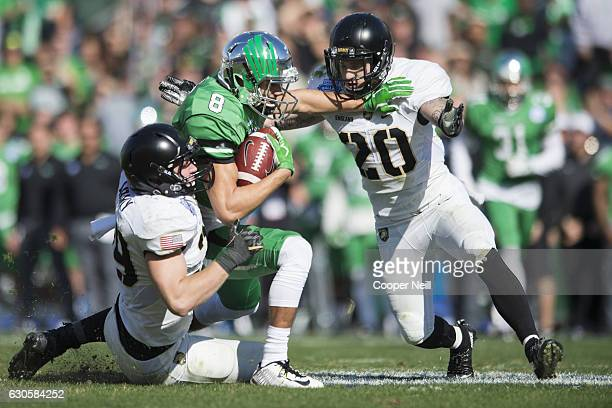 Rico Bussey Jr #8 of the North Texas Mean Green is brought down after the catch by the Army Black Knights defense during the 1st half of the Zaxby's...