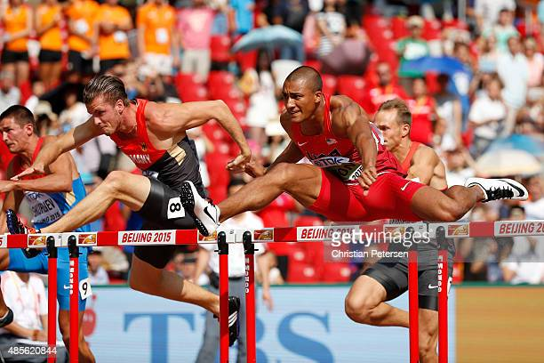 Rico Freimuth of Germany and Ashton Eaton of the United States compete in the Men's Decathlon 110 metres hurdles during day eight of the 15th IAAF...
