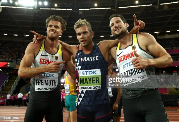 Rico Freimuth of Germany silver Kevin Mayer of France gold and Kai Kazmirek of Germany bronze celebrate after the Men's Decathlon 1500 metres during...