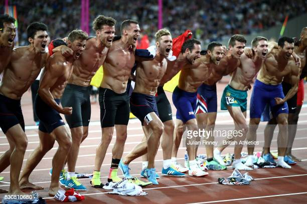 Rico Freimuth of Germany, silver, Kevin Mayer of France, gold, and Kai Kazmirek of Germany, bronze, celebrate with the other athletes after the Men's...