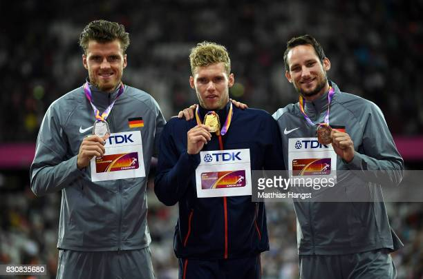 Rico Freimuth of Germany silver Kevin Mayer of France gold and Kai Kazmirek of Germany bronze pose with their medals for the Men's Decathlon during...