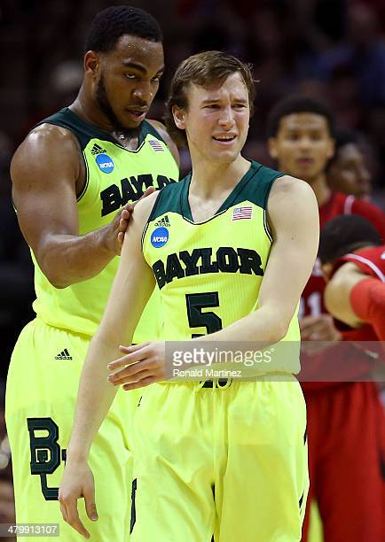 Rico Gathers and Brady Heslip of the Baylor Bears react after a play in the first half against the Nebraska Cornhuskers during the second round of...