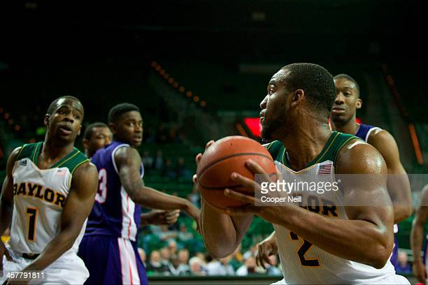 Rico Gathers of the Baylor Bears gathers a rebound against the Northwestern State Demons on December 18 2013 at the Ferrell Center in Waco Texas