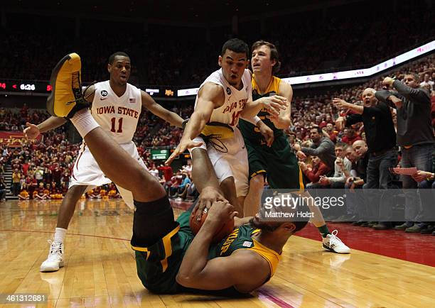 Rico Gathers of the Baylor Bears grabs a loose ball during the second half in front of Mont Morris and Naz Long of the Iowa State Cyclones on January...