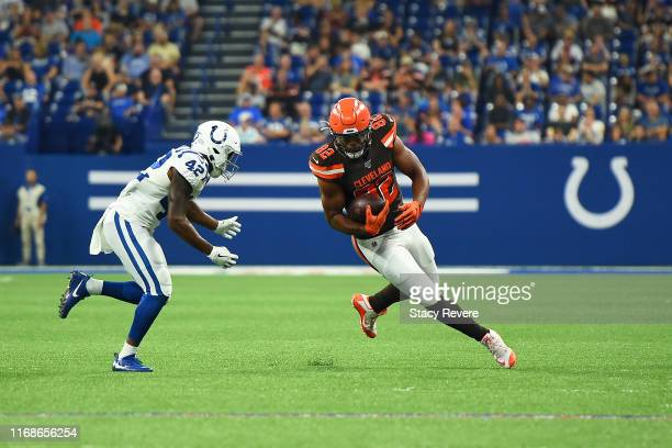 Rico Gathers of the Cleveland Browns is pursued by Rolan Milligan of the Indianapolis Colts during the second half of a preseason game at Lucas Oil...