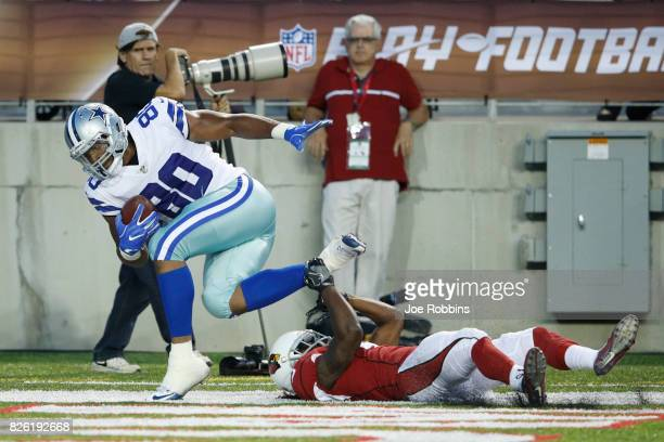 Rico Gathers of the Dallas Cowboys makes a 26yard touchdown reception against Ironhead Gallon of the Arizona Cardinals in the first quarter of the...