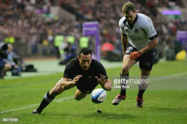 Rico Gear of New Zealand scores the first try during the Bank of Scotland Corporate Autumn Test Series match between Scotland and New Zealand at...