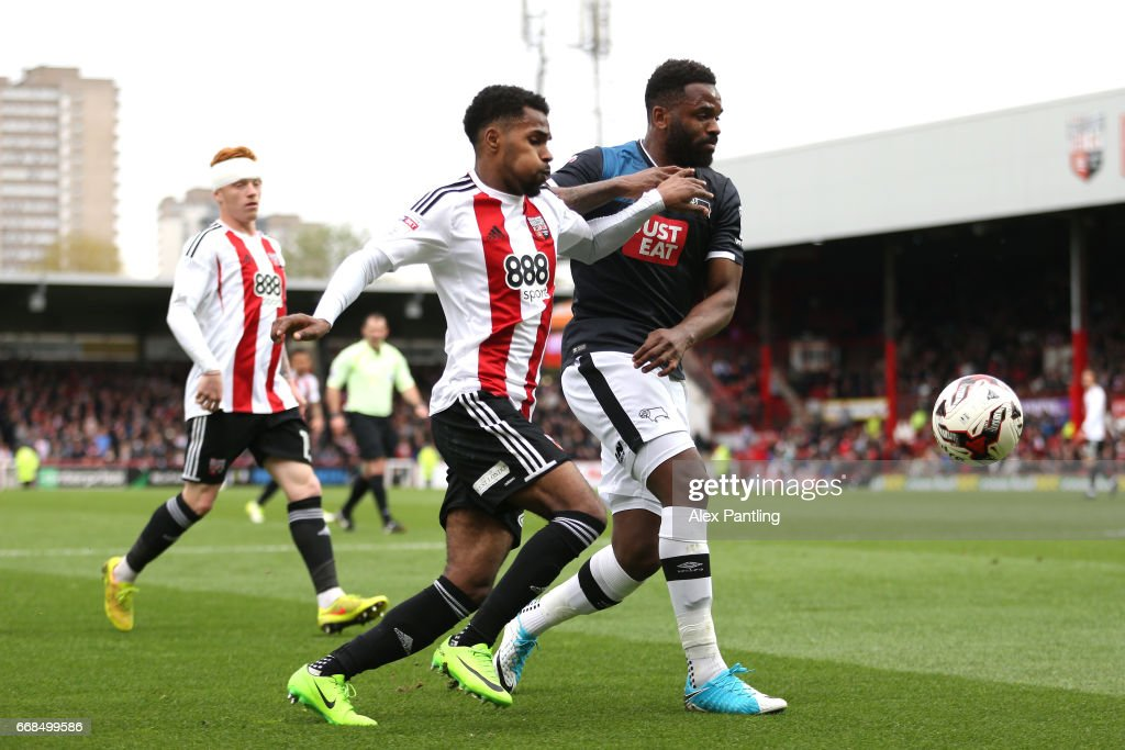 Rico Henry of Brentford and Darren Bent of Derby County in action during the Sky Bet Championship match between Brentford and Derby County at Griffin Park on April 14, 2017 in Brentford, England.