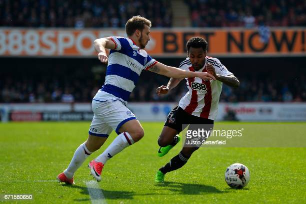 Rico Henry of Brentford and Luke Freeman of Queens Park Rangers during the Sky Bet Championship match between Brentford and QPR at Griffin Park on...