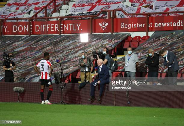 Rico Henry of Brentford is socially distanced interviewed by Sky Sports Television after the Sky Bet Championship Play Off Semifinal 2nd Leg match...