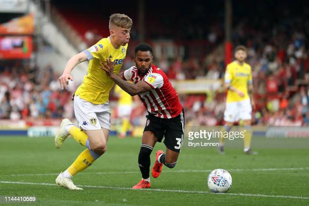 Rico Henry of Brentford is tackled by Jack Clarke of Leeds United during the Sky Bet Championship match between Brentford and Leeds United at Griffin...