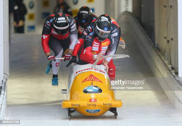 Rico Peter of Switzerland competes with Alex Baumann Simon Friedli and Michael Kuonen at Deutsche Post Eisarena Koenigssee during the BMW IBSF World...