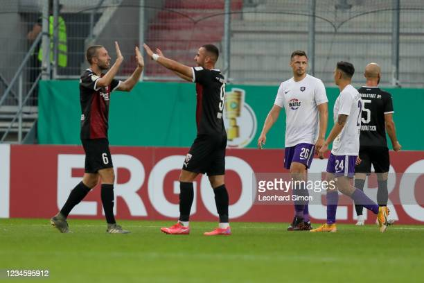Rico Preißinger and Fatih Kaya of FC Ingolstadt celebrate their victory over Erzgebirge Aue after the DFB Cup first round match between FC Ingolstadt...