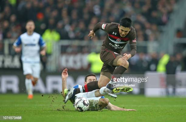 Rico Preissinger of 1 FC Magdeburg and Ryo Miyaichi of FC St Pauli battle for the ball during the Second Bundesliga match between FC St Pauli and 1...