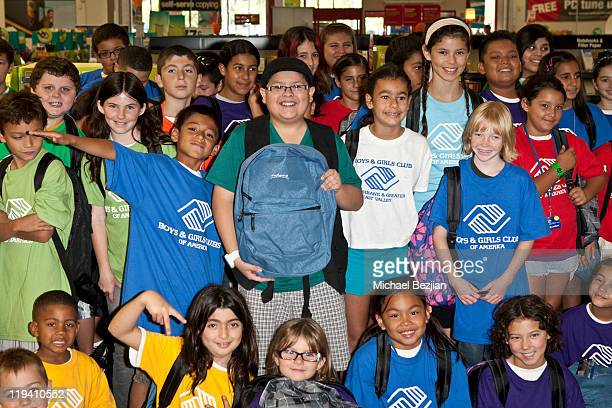 Rico Rodriguez and kids from the Boys and Girls Club of America at the Staples Back To School Event at Staples on July 19 2011 in Burbank California