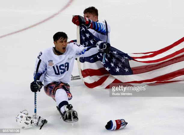 Rico Roman of the United States celebrates winning the gold medal over Canada in the Ice Hockey gold medal game between United States and Canada...