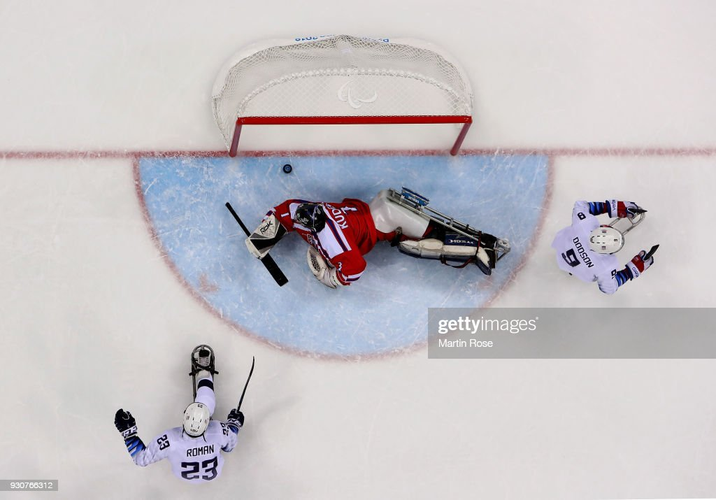 Rico Roman of United States is scoring a goal over Martin Kudela, goaltender of Czech Republic in the Ice Hockey Preliminary Round - Group B game between United States and Czech Republic during day three of the PyeongChang 2018 Paralympic Games on March 12, 2018 in Gangneung, South Korea.