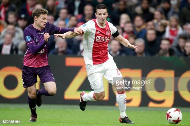 Rico Strieder of FC Utrecht Nick Viergever of Ajax during the Dutch Eredivisie match between Ajax v FC Utrecht at the Johan Cruijff Arena on November...