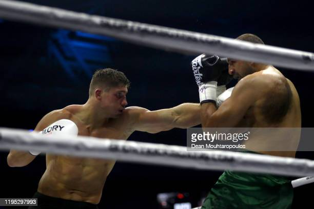 Rico Verhoeven of Netherlands and Badr Hari of Morocco battle during their World Heavyweight Title kickboxing bout at GLORY 74 Arnhem / Collision 2...