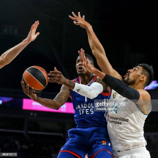 Ricy Ledo of Anadolu Efes in action against Gustavo Ayon of Real Madrid during the Turkish Airlines Euroleague basketball match between Anadolu Efes...