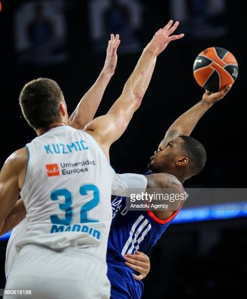 Ricy Ledo of Anadolu Efes in action against Ongjen Kujmic of Real Madrid during the Turkish Airlines Euroleague basketball match between Anadolu Efes...