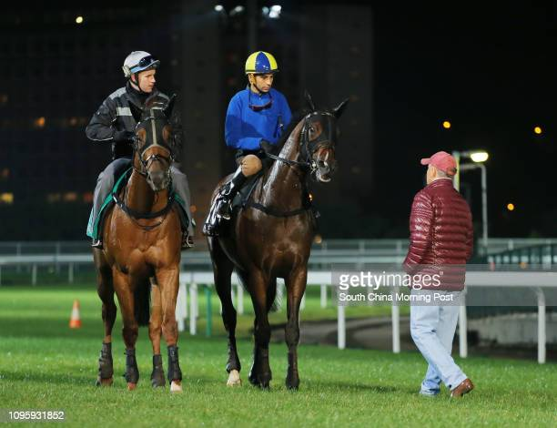 ridden by Joao Moreira and SECRET SHAM ridden by Tommuy Berry going back to stable after gallop on the turf at Sha Tin John Moore looking the horse...
