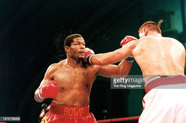 Riddick Bowe is hit with a left hook from Andrew Golota during a fight at the Convention Center on December 14 1996 in Atlantic City New Jersey...
