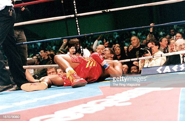 Riddick Bowe lays on the canvas after being knocked out by Andrew Golota during a fight at the Convention Center on December 14 1996 in Atlantic City...