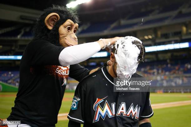 Riddle of the Miami Marlins is pied in the face by Miguel Rojas after they defeated the New York Mets 82 at Marlins Park on June 29 2018 in Miami...