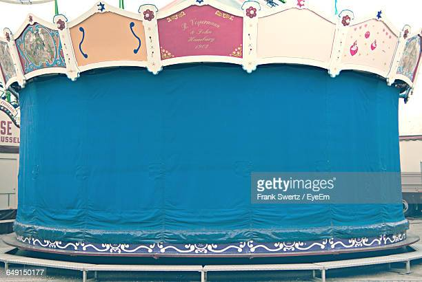 ride covered with blue tarpaulin at amusement park - frank swertz stock pictures, royalty-free photos & images