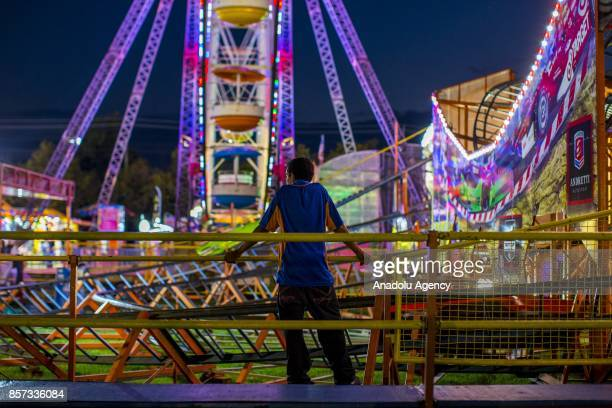 A ride operator waits for the riders to come back around on the roller coaster set up at The Great Frederick Fair in Frederick Md United States on...