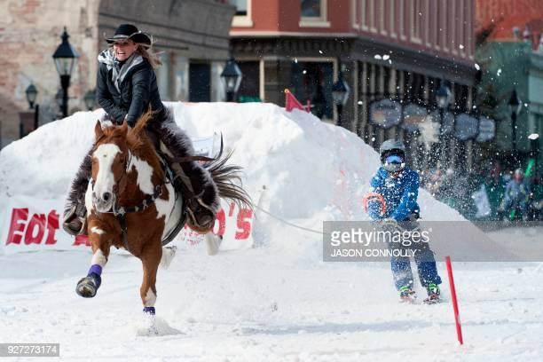 Rider Amber West and skier Shawn Gerber race down Harrison Avenue during the 70th annual Leadville Ski Joring weekend competition on March 4 2018 in...