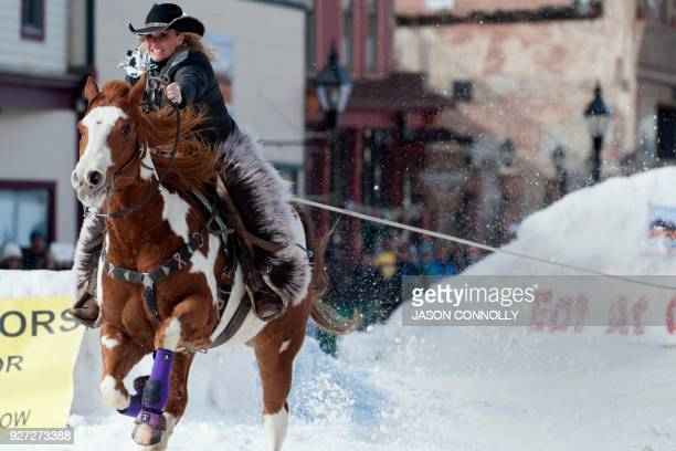 Rider Amber West pulls skier Shawn Gerber down Harrison Avenue during the 70th annual Leadville Ski Joring weekend competition on March 4 2018 in...