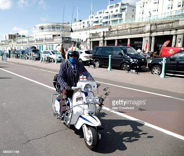A rider arrives on the seafront during the Brighton Mod Weekender where mods and their scooters gather on the annual bank holiday weekend event on...