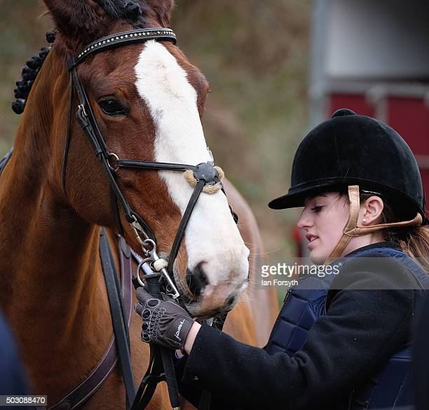 Rider checks her horse's bridle as the Cleveland Hunt prepare to ride out on the traditional New Year's Day hunt on January 1, 2016 in Guisborough,...