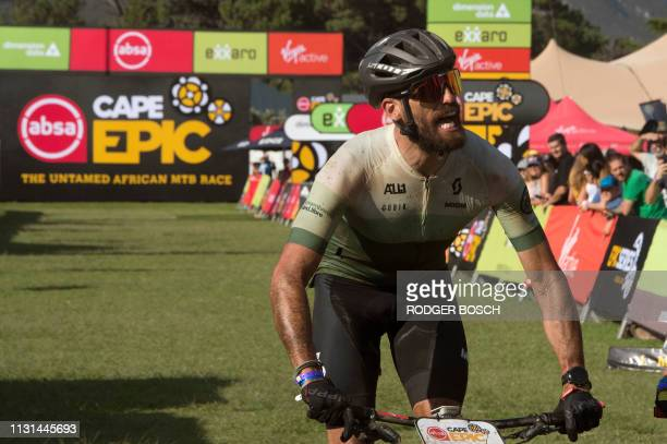 A rider cheers after just making the 10 hour cutoff time to complete the first full stage of the 2019 Cape Epic mountain bike stage race on March 18...
