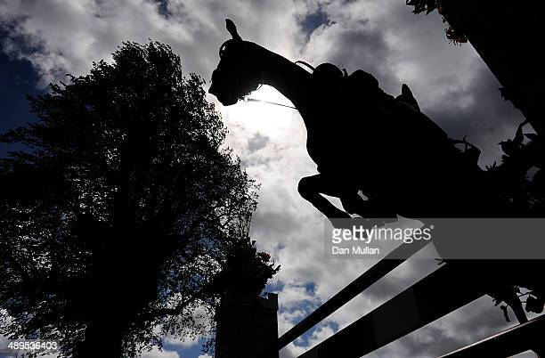 A rider clears an obstacle during the Show Jumping on day five of the Badminton Horse Trials on May 11 2014 in Badminton England