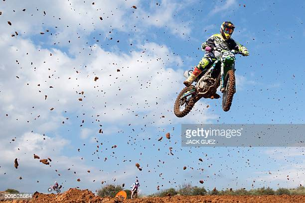 TOPSHOT A rider comes off a jump during the inauguration of the MX Wingate Motocross track near the Israeli city of Netanya on February 11 2016 / AFP...