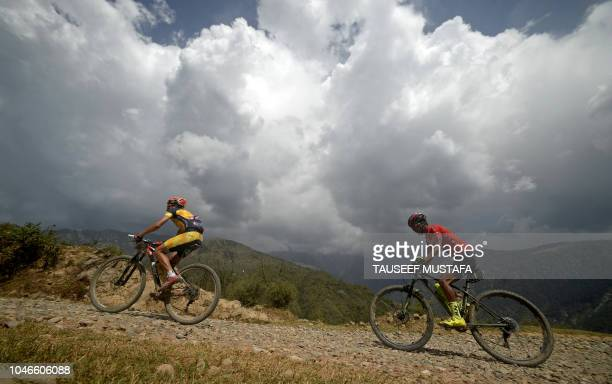Rider compete in the 14th edition of the Hero MTB Himalaya mountain bike race during a final day at Dharamshala in the northern Indian state of...