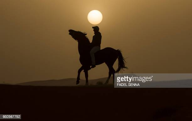 TOPSHOT A rider competes during the Gallops of Morocco equestrian race in the desert of Merzouga in the southern Moroccan Sahara desert on March 1...