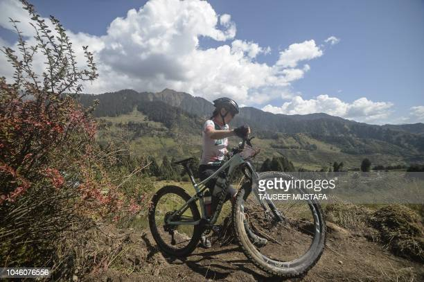 A rider competes in the 14th edition of the Hero MTB Himalaya mountain bike race in the northern Indian state of Himachal Pradesh on October 5 2018...